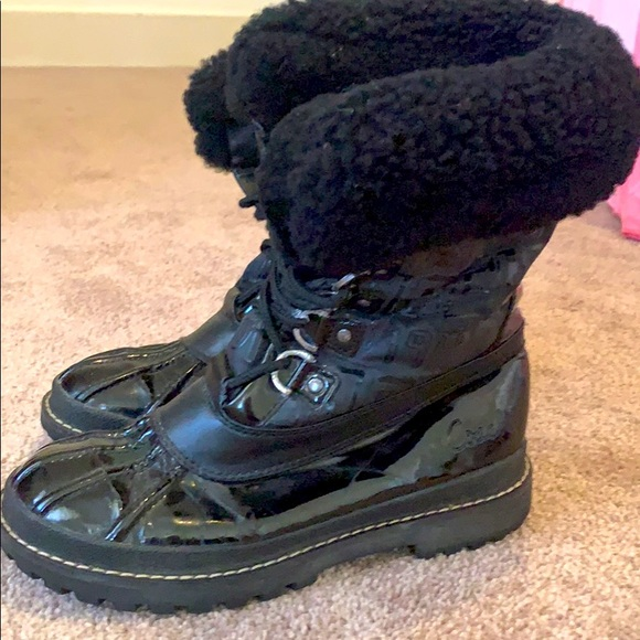Black woman's Coach Winter boots